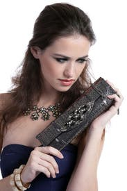 Love Torn Clutch by Carlos Falchi